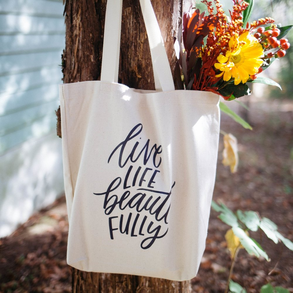 """Live Life Beautifully"" bag hand-lettered by our friend Sarah Kim!"