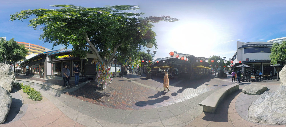 WALKING WITH GRACE  [2016]  A 360 virtual reality documentary viewable via VR headsets on a mobile kiosk throughout various locations of the festival. The short documentary,  Walking with Grace,  highlight places and streets of Little Tokyo through the perspective of Grace Chikui, a blind woman and long-time resident.   VR Director: Vicki Huang, Co-directors/producers: Joel Quizon, Maya Santos, Executive Producer: Eseel Borlasa, Sharon Lee, Assistant Producer: Elaine Dolalas, Graphics: Francisco Garcia Nava    ©Vicki Huang, 360 scene from Walking with Grace