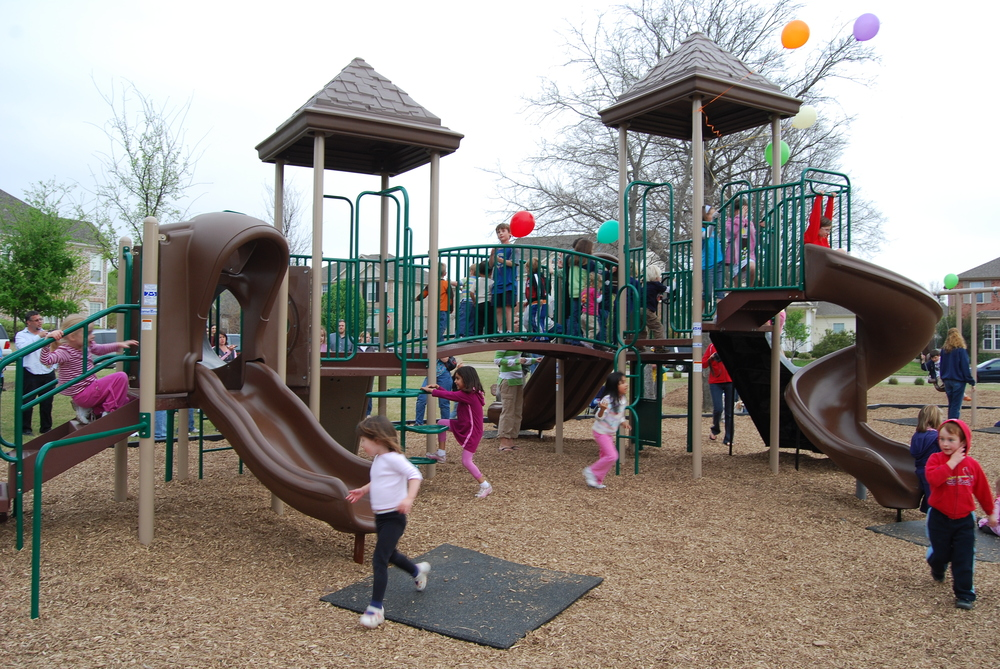 The Primrose Park playground was constructed by neighbors in 2008. It features two rock walls, three slides, a crawl tunnel, a bridge, fireman's pole and other climbing structures. There are also 2 baby swings and 2 paddle seat swings.