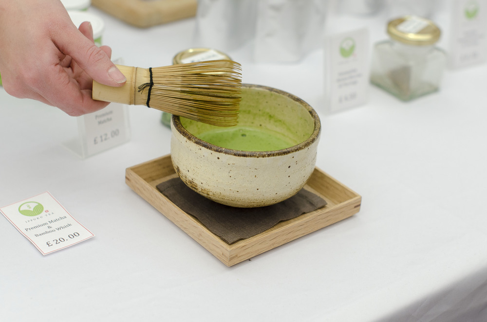 Watch demonstrations; here a vendor shows visitors how to prepare traditional green tea (matcha)