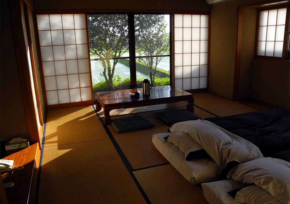 A traditional ryokan, complete with kotatsu (low table), futon and tatami mats