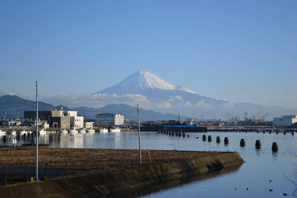 Mount Fuji among factories at Shimizu Port.