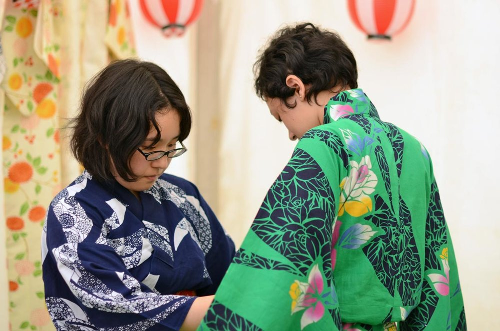 A helping hand might be needed when getting dressed in kimono for the first time