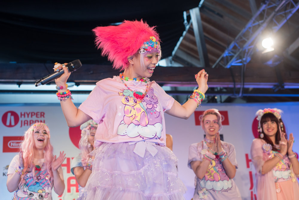 Haruka Kurebayashi modelling her Dreamy Bows fashion collaboration and performing on stage