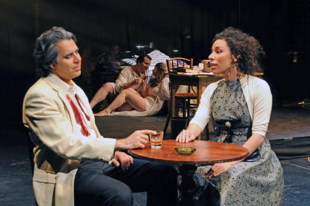 (l. to r.) Joe Flaxman (Harry), Joe Shadday (Ahmed), Danielle Connelly (Lizzy), and Mimi Melisa Bonetti (Clare) in the Kentucky Opera premiere production of A Woman in Morocco.