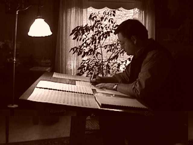 "Daron Hagen copying the full score of his opera ""Bandanna"" in Milwaukee in winter, 1998. (Photo: Ryan Hagen)"
