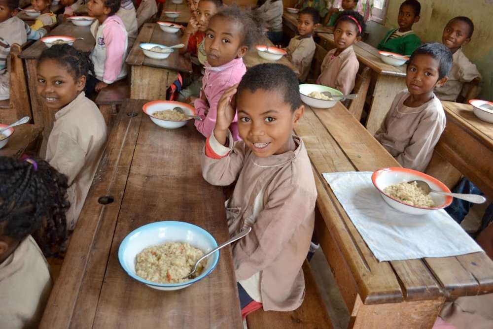 Rise Against Hunger meals served to children in Madagascar.