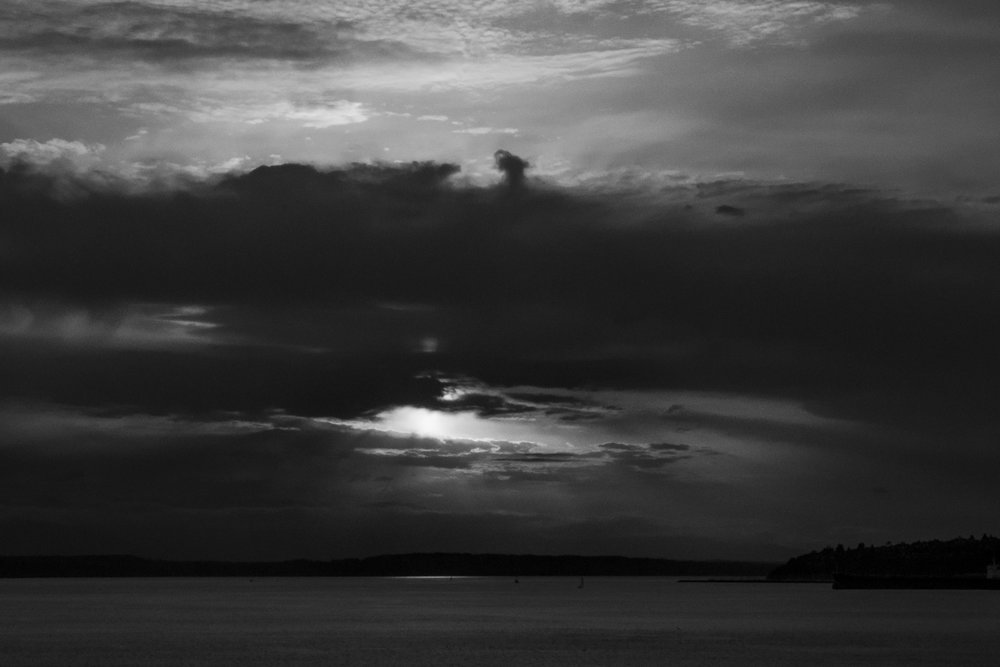 "To quote Travis Lovell (my professor at UVU) when I asked him why he took sunset pictures with black and white film, he said ""Sunsets still have value""  I took this 2 ways, they have value in density and luminance, as well as in beauty. This is the only sunset I've ever liked in black and white."