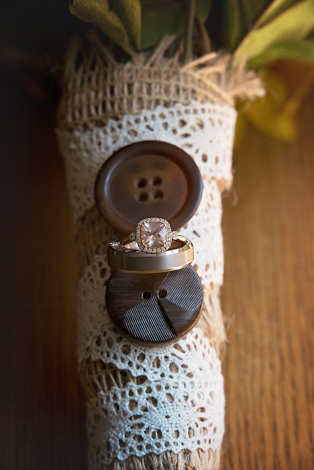 Detail shot of the bride's engagement ring & the groom's wedding ring on the bride's gorgeous DIY bouquet.