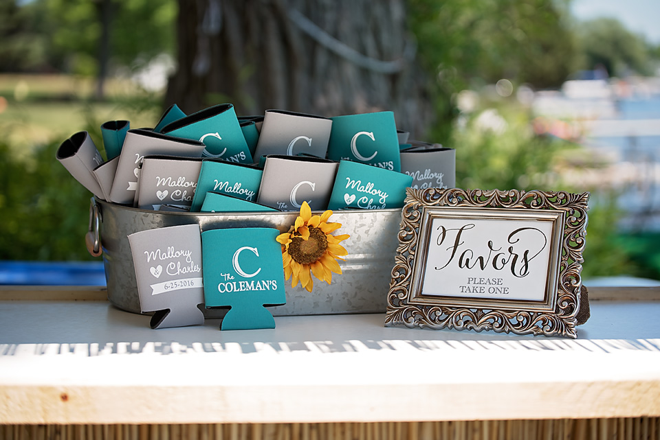 Personalized beer koozies served as wedding favors for guests