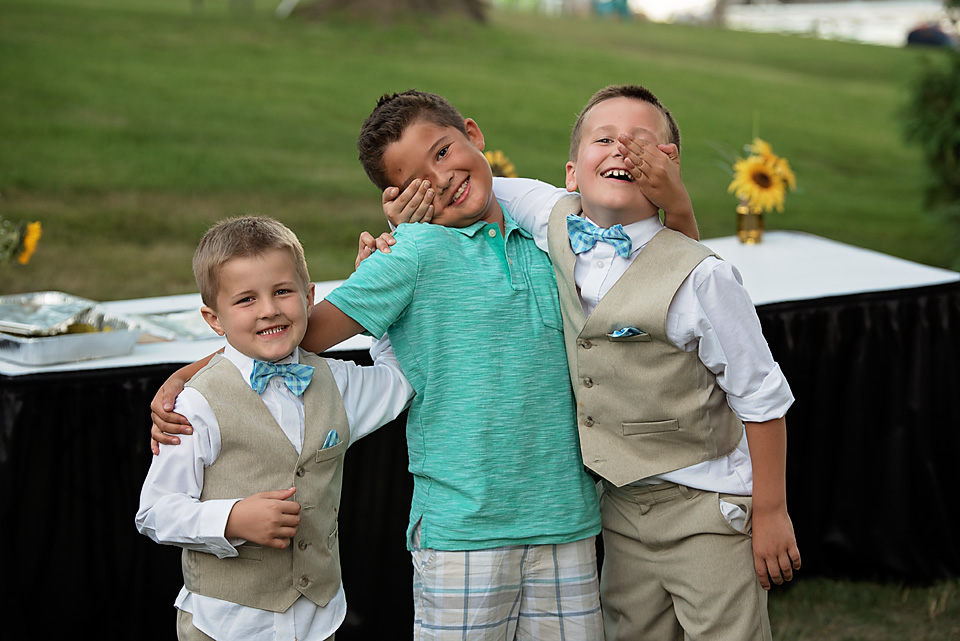 Mallory's sons & Lucy's son acting silly during the reception