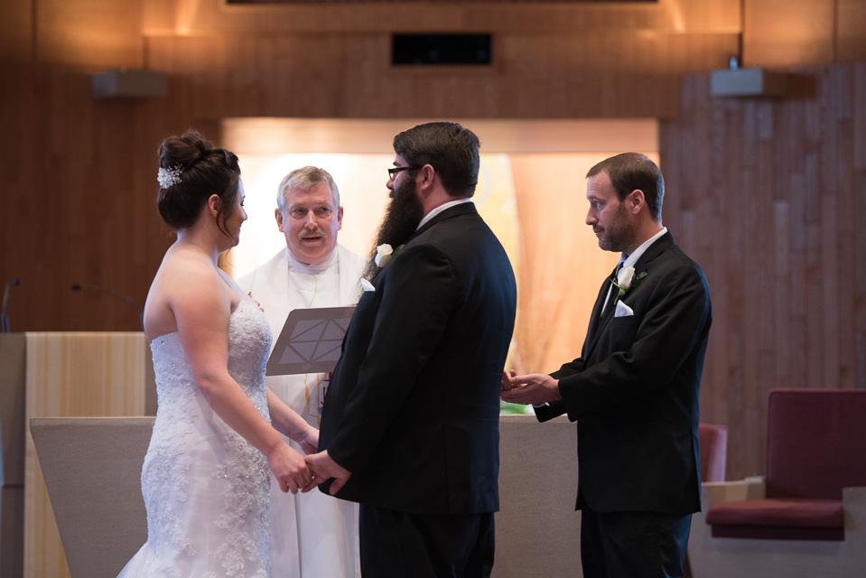 17.04.01_Napela Wedding-22best man, bride, ceremoy, church, Groom, Lapum-Napela Wedding, livonia, michigan, rings.jpg