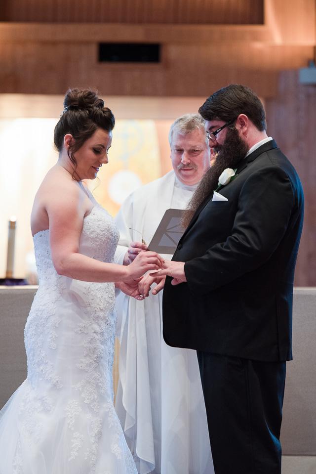 17.04.01_Napela Wedding-24bride, ceremoy, church, exchange of rings, Groom, Lapum-Napela Wedding, livonia, michigan, rings.jpg