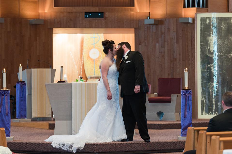 17.04.01_Napela Wedding-28bride, ceremoy, church, first kiss, Groom, Lapum-Napela Wedding, livonia, michigan.jpg