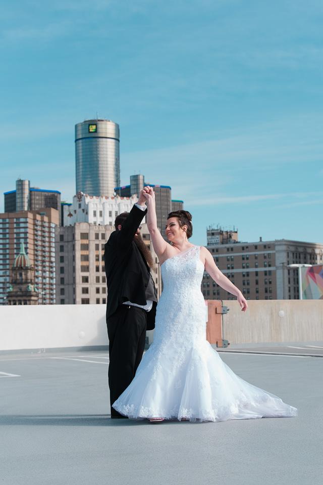 17.04.01_Napela Wedding-40.6bride, dance, Detroit, downtown detroit, Groom, Lapum-Napela Wedding, rencen, the z parking garage, wedding gown.jpg