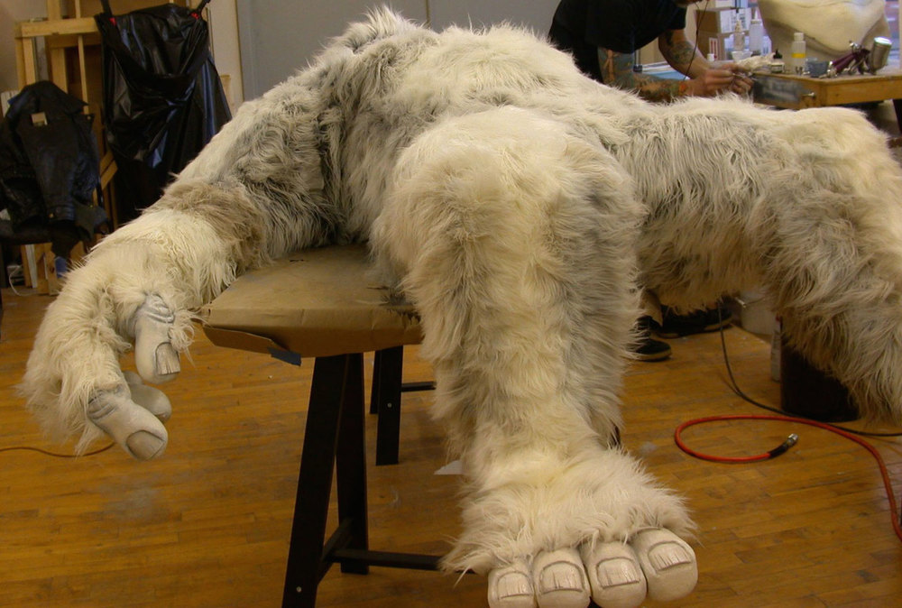 Here we have a Yetti costume.  I cut foam with a razor and a saw, used a heat gun to refine the shape, glued fur, airbrushed fur,  and painted nails for designer Geahk Burchil at GB Designs to help create this incredible costume!