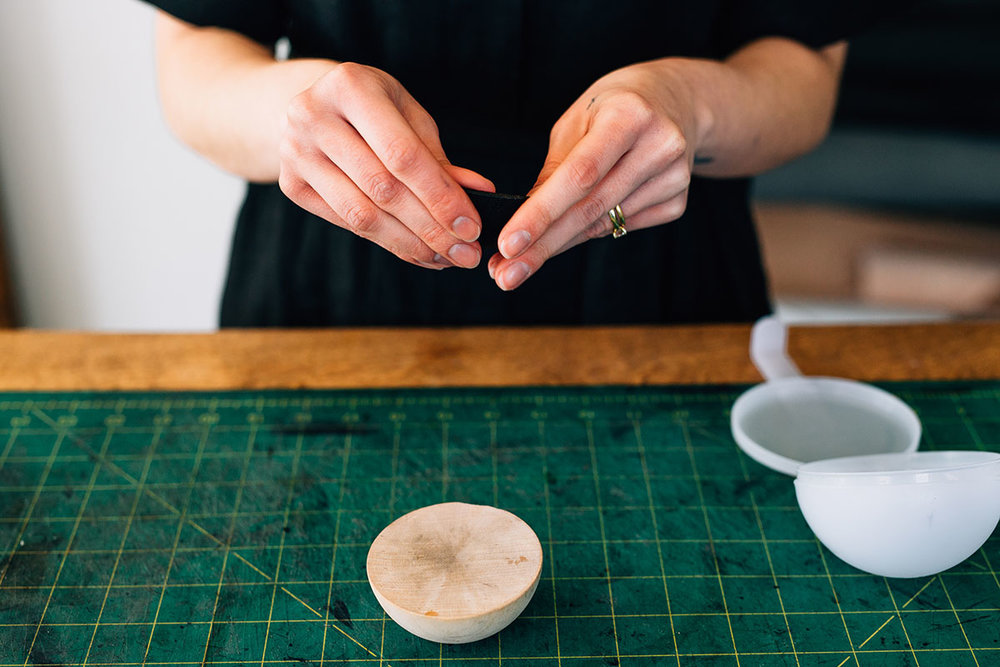 Megan wet molding and forming a leather bowl in the Stitch & Shutter Studio