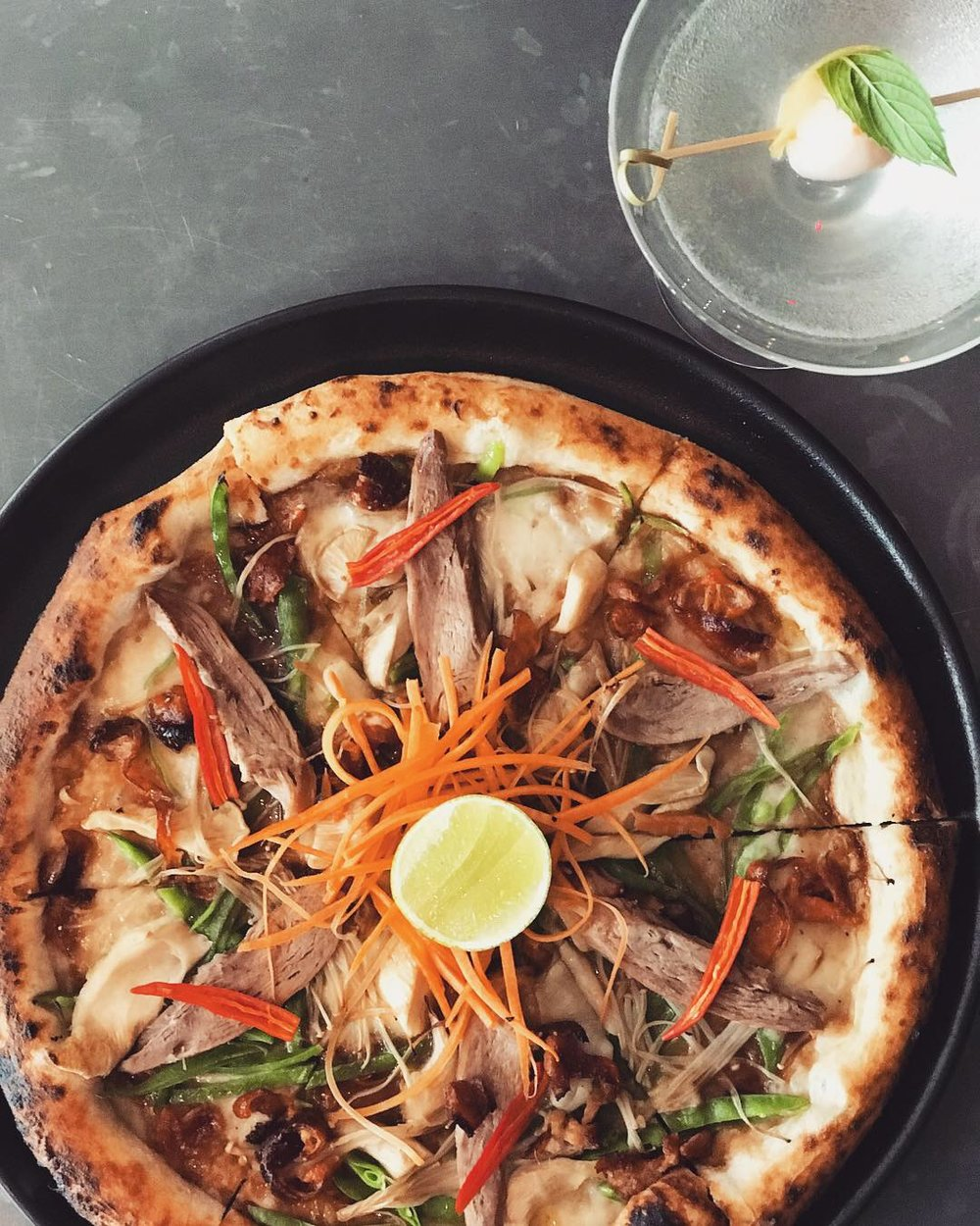 5-13 February - Our Shanghai Pizza marries a pasture fed, 4-hour braised Maryland duck, oyster and enokitake mushrooms, snow peas, chilli, Fior di Latte mozzarella, and a delicious five-spice roasted plum purée base.Best served with our Lychee Martini 🍸 .This week only, in celebration of the Year of the Pig.