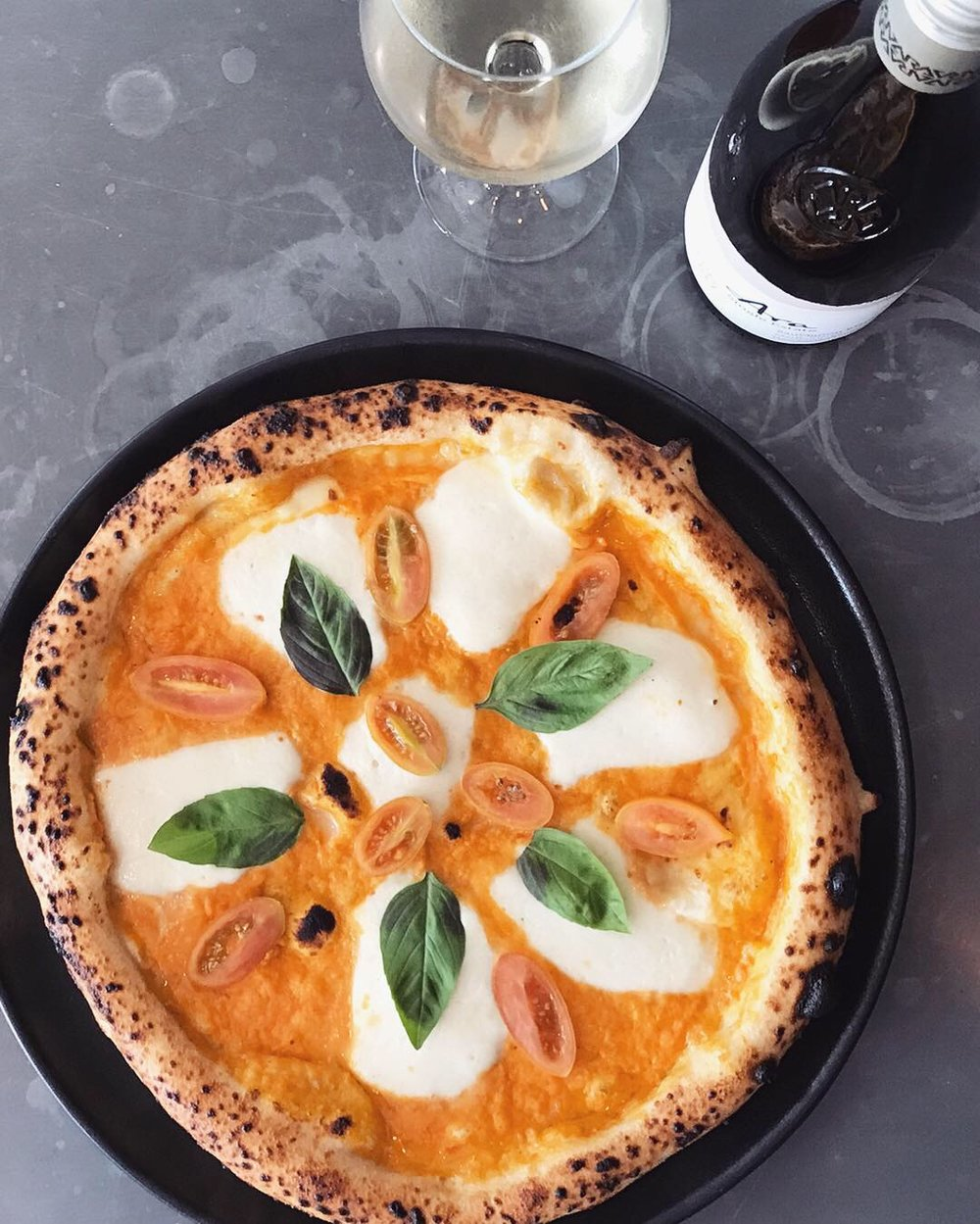 27 Feb - 5 Mar - I bet you've never seen a Margherita like that!Yellow heirloom tomato, fior di latte mozzarella, basil and the youngest, lightest extra virgin olive oil.This week we see things in a different colour!Perfectly matched with a light and fruity Ara Sauvignon Blanc (Marlborough, NZ).