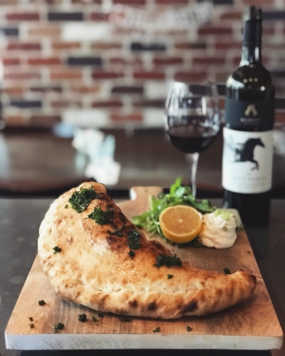 17-28 April - Spicy Stuffed CalzoneLarge wood-fire pizza pocket stuffed with the most tender spicy sous vide beef cheeks, fresh ricotta and chives.Recommended with a glass of Malbec or Pinot Noir.