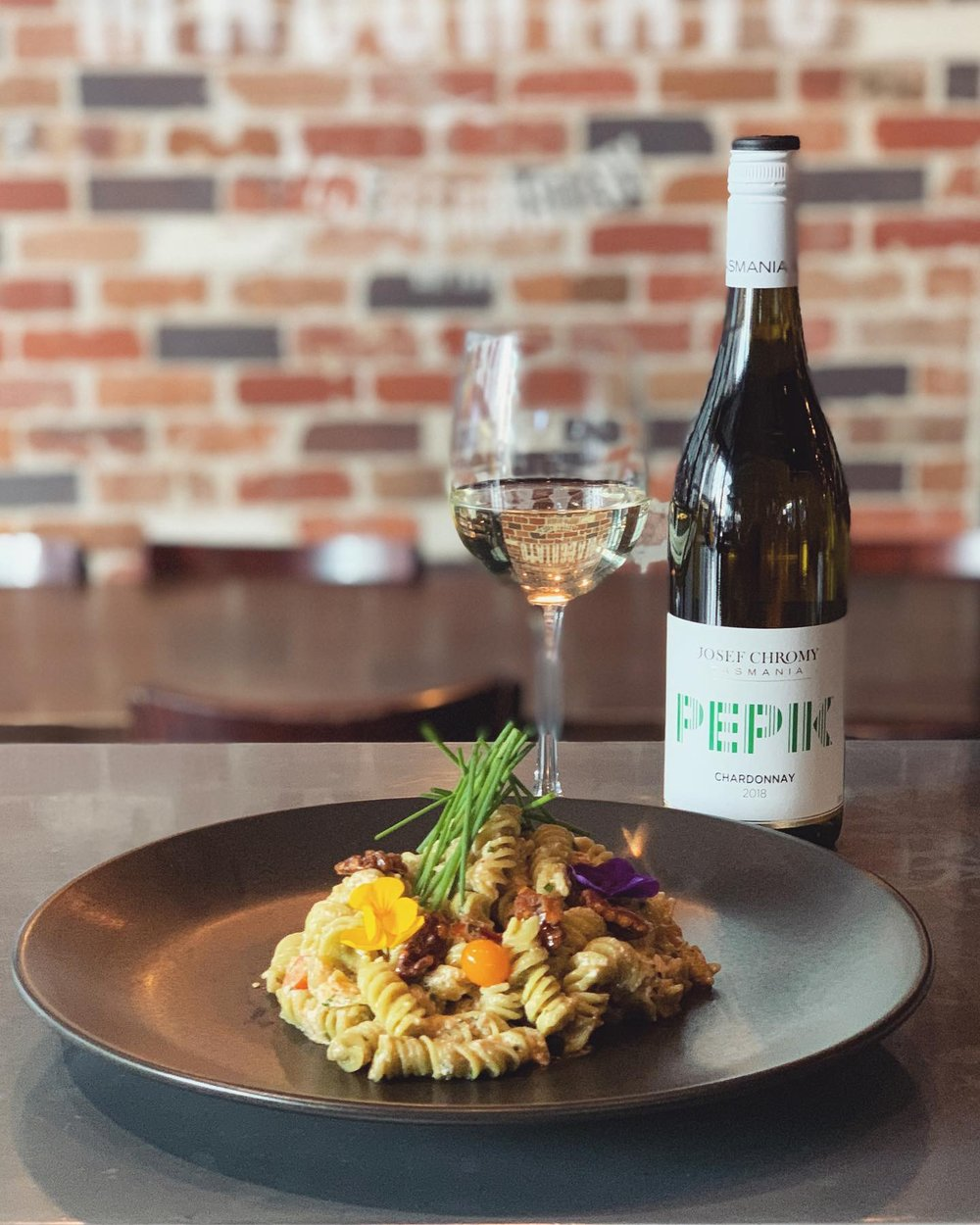 8-14 May - One of our weekly specials this week: homemade spinach fusilli with pan-tossed heirloom tomatoes, toasted walnuts, cream of ricotta and EV olive oil.Best enjoyed with a glass of our resident wine, Josef Chromy 'Pepik' Chardonnay (TAS).