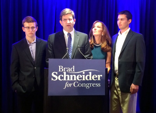 Brad Schneider with wife, Julie, and sons Daniel and Adam during his concession speech on Tuesday night.  (Photo by Ramsen Shamon)