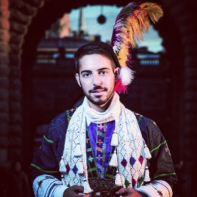 Robert Hannah wearing traditional Assyrian clothes.