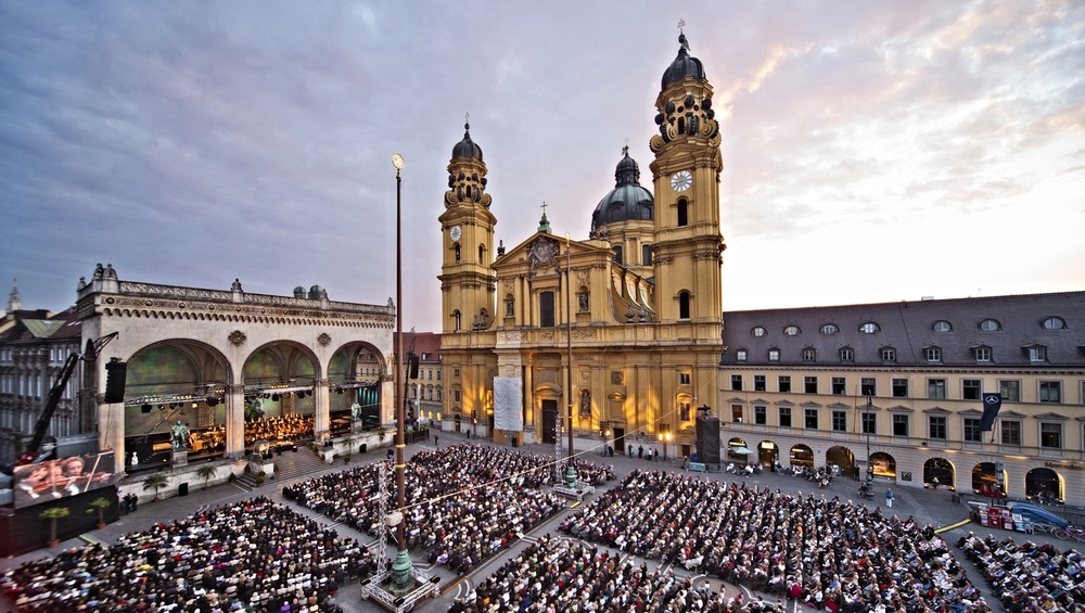 Where time is thin: Munich's Odeonsplatz with the Feldherrnhalle (left) and the Theatiner Kirche. The square is a spot for cultural activities today (like this concert).  In 1923 it was famous as the place where Hitler's mob marched before he was arrested.  The monument with the arches was built in 1844 by King Ludvig of Bavaria to honor his Generals. The church was built in 1690, but not finished until 100 years later.  The whole complex is situated at what was once the north gate in Munich's city wall, built in 1391.  The city first appears in written records in the 1150s, but there were Benedictine monks on the site as early as the 700s.  The Romans built in cities all around, but ignored this spot, where there has been a settlement since around 4,000 BC.