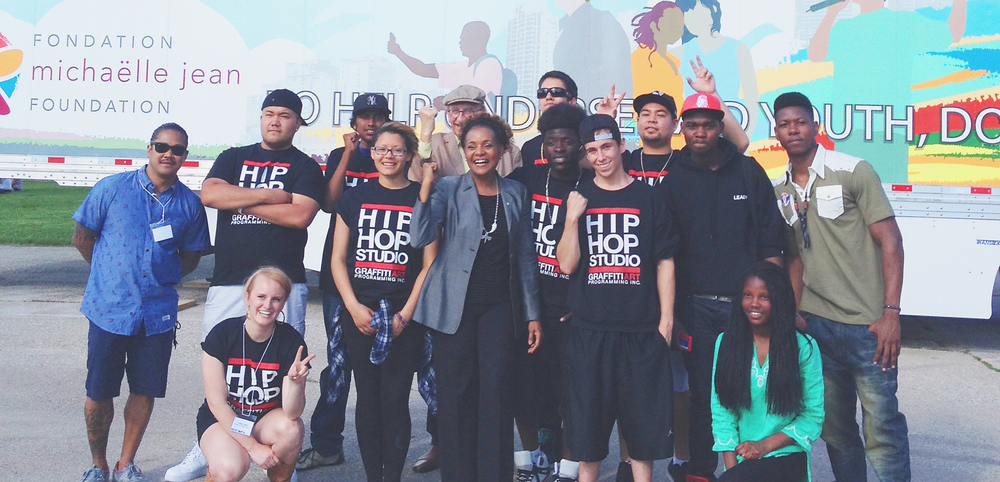The Honorable Michaëlle Jean with our Young Leaders and Studio 393 Hip Hop Studio groups at the unveiling of the ART SAVES LIVES Bison Transport Truck. Learn more about the initiative.