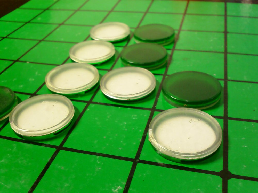 """ Othello (Reversi) board "" BY  Paul_012  IS LICENSED UNDER  CC BY-SA 3.0 ."