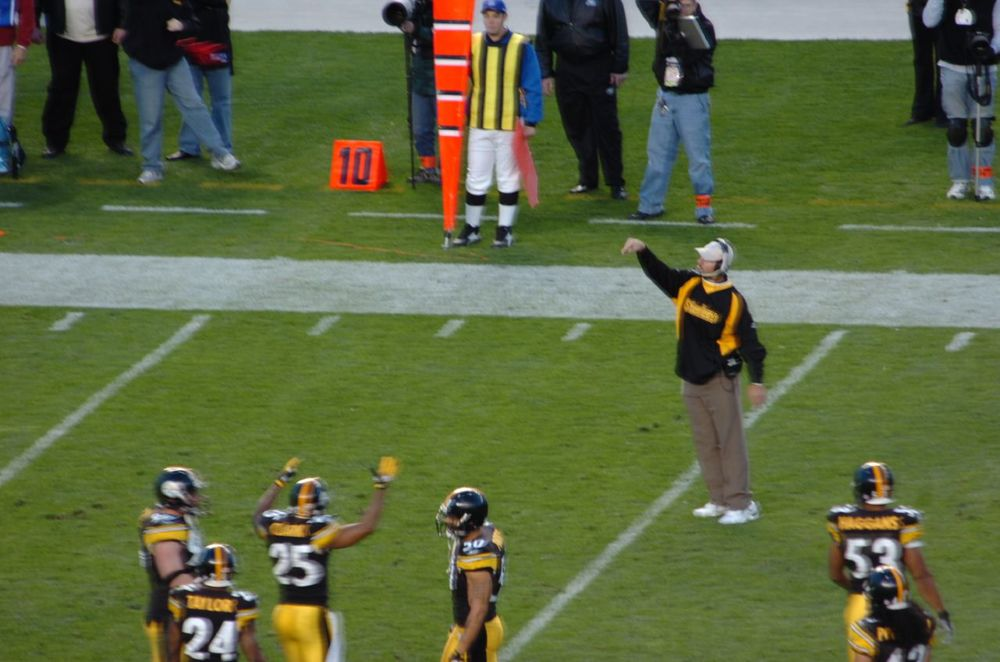 """ Bill Cowher throws the challenge flag "" by  SteelCityHobbies  is licensed under  CC BY 2.0 ."