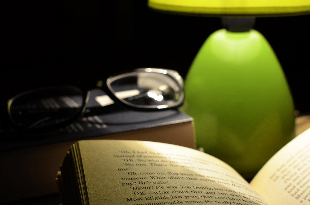 """ Light, dark, bed, lamp "" by  Breakingpic  is  public domain ."