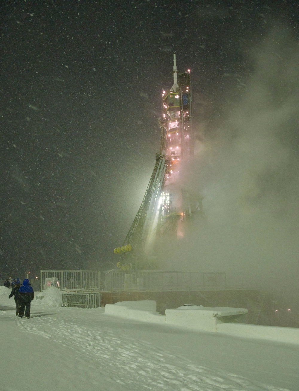 """ Soyuz TMA-22 rocket during a snow storm the morning of the launch "" by  NASA / Carla Cioffi  is  Public Domain ."