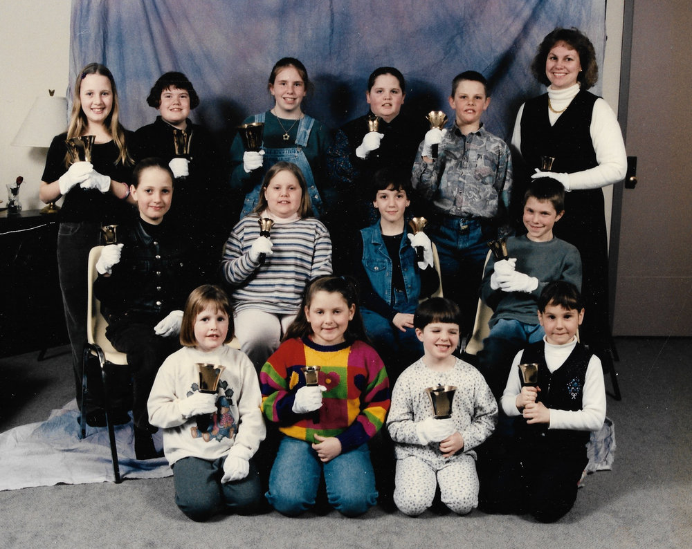 Hand Bells 1997 Back row L-R:  Jessica Friedman, Heather Johnston, Nikki Vernon, Nicole Kaufman, Jamie Claus, Agnes Lockie/Henderson (Director)  Middle row:  Katelyn Friedman, Michelle Mack, Katie Morse, Kurtis Vernon  Front row:  Terry Brown, Cory Newbigging, Natalie Robinson, Alicia Lockie