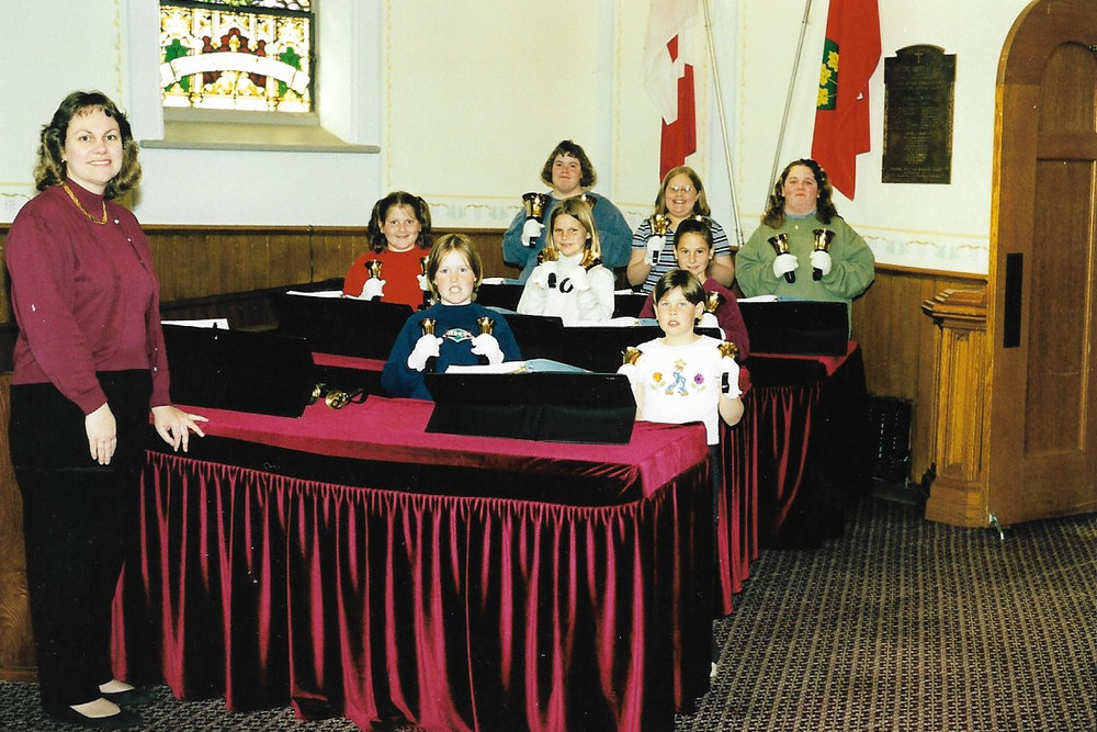 Hand Bells 1999 Back Row L-R:  Heather Johnston, Michelle Mack, Nicole Kaufman  Middle Row L-R:  Cory Newbigging, Lauren Karges, Alicia Lockie  Front Row L-R:  Agnes Lockie/Henderson (Director); Terry Brown, Brittany McDonald