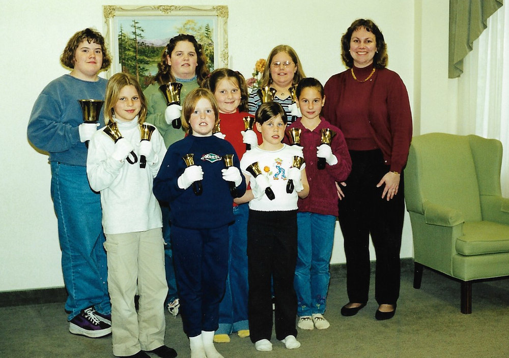 Hand Bells 1999 Back Row L-R:  Heather Johnston, Nicole Kaufman, Michelle Mack, Agnes Lockie/Henderson (Director)  Middle Row L-R:  Lauren Karges, Cory Newbigging, Alicia Lockie  Front Row L-R:  Terri Brown, Brittany McDonald