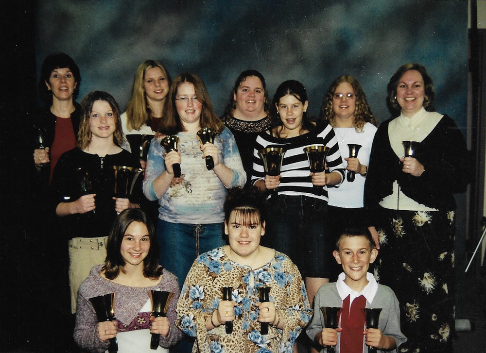 Hand Bells 2004 Back Row L-R:  Janet McDonald, Lauren Karges, Nicole Kaufman, Michelle Mack, Agnes Lockie/Henderson (Director)  Middle Row L-R:  Kelsey Linstead, Terry Brown, Brittany McDonald,  Front Row L-R:  Alicia Lockie, Heather Johnston, Lee Mayes