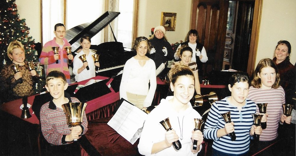 Hand Bells 2002   (taken at Livingston Manor, December 2002)   Back Row L-R:  Emily Strachan, Lauren Karges, Kelsey Linstead, Nicole Kaufman, Heather Johnston  Middle Row L-R:  Lee Mayes, Hadleigh Neable, Natalie Robinson, Agnes Lockie/Henderson (Director)  Front Row L-R:  Alicia Lockie, Brittany McDonald, Terri Brown