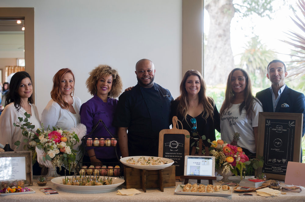 Pictured: Here we have our amazing team! Project Invite, Montperi Catering, Sipistry Drinks, Tirzahs Kitchen, and ,of course, von der Leith Studios owners behind our beautiful table for the showcase.