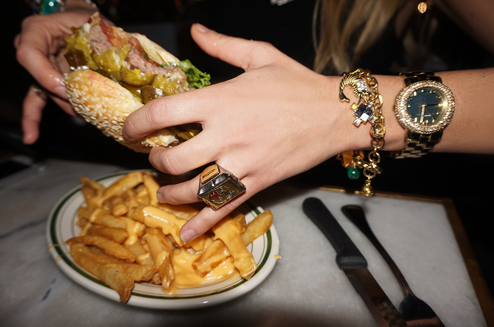 (from left): Bill's Bar & Burger Spicy Jalapeño Burger (available here); George Frost Enemy ring and Allegory charm bracelet (available here and here); Vintage watch