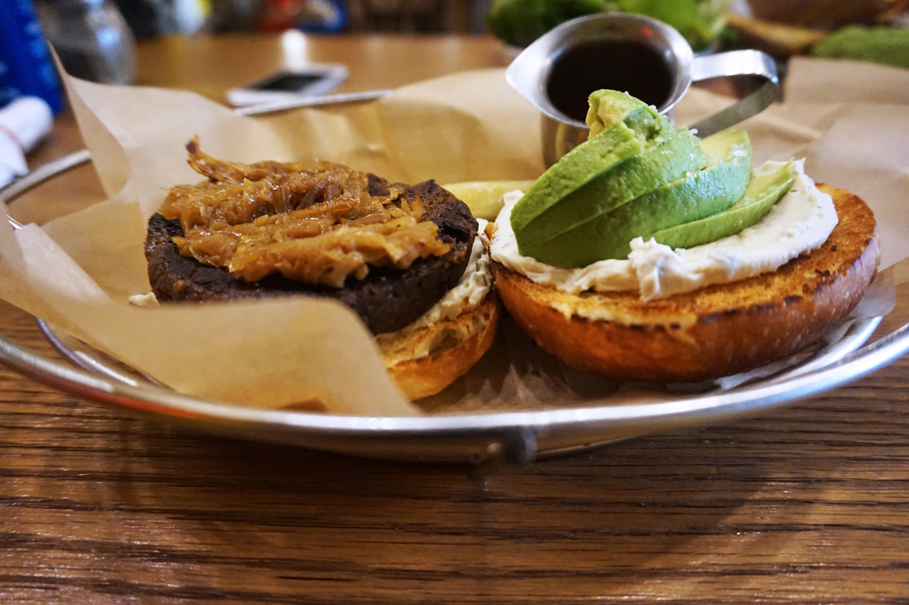 California Mob Burger by  Mob Brooklyn : crimini mushroom burger, house baked sweet potato roll, avocado slices, herbed cashew cheese, caramelized onions