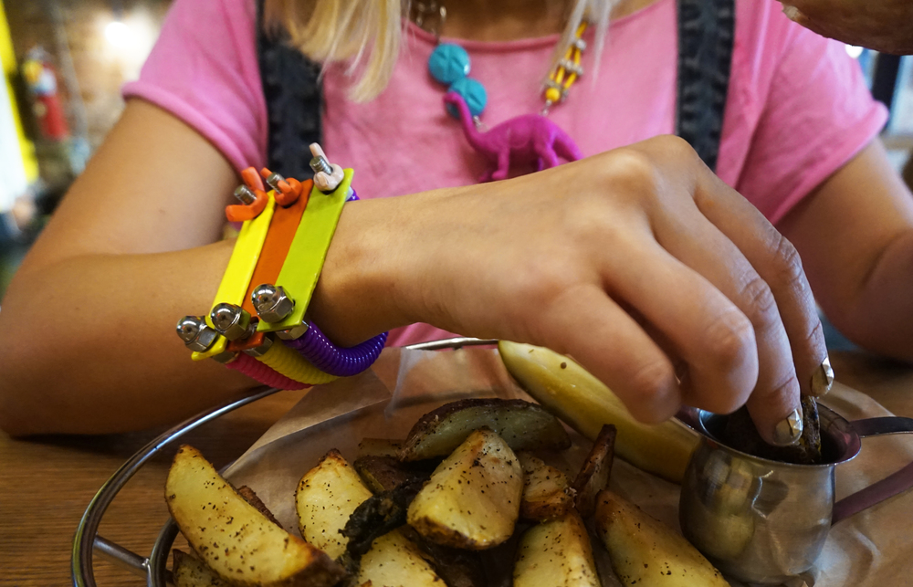(from left):   Issy Salomon   Memphis bracelets in pink, yellow, & purple and Dinosaur necklace (available   here  )