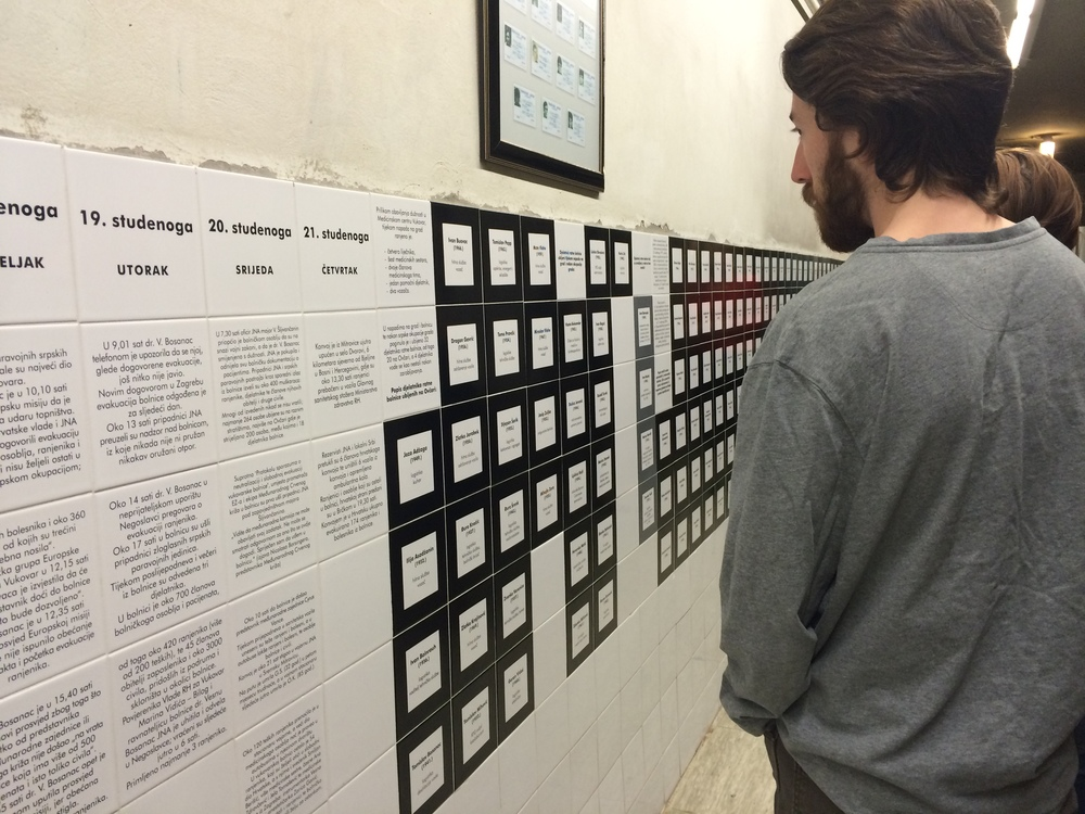 Reading the names of individuals who died during the massacre.