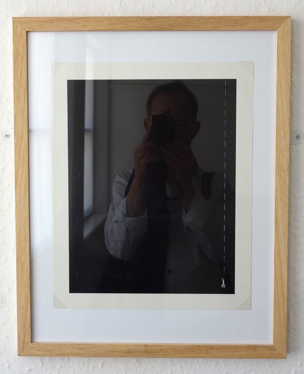 David Ward in 2017 photographing a framed work by Barry Flanagan:  Black Ad  197 0