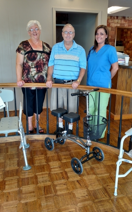 Brande shows Mr. and Mrs. Pearson, the first visitors at our new location, around the showroom.