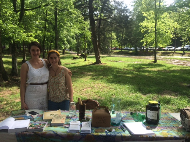 Morgan, Deep Roots' current intern and apothecary manager, and Cameron tabling at the Montevallo Let's Get Moving Festival!