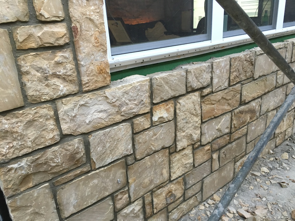 Space under windows for flagstone ledges