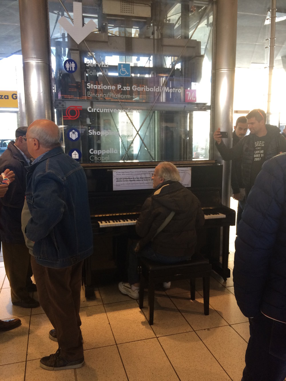 Though regretfully not taken the same day as my recent musical encounter, there is always some sort of show to be found a Napoli's central station and her piano.