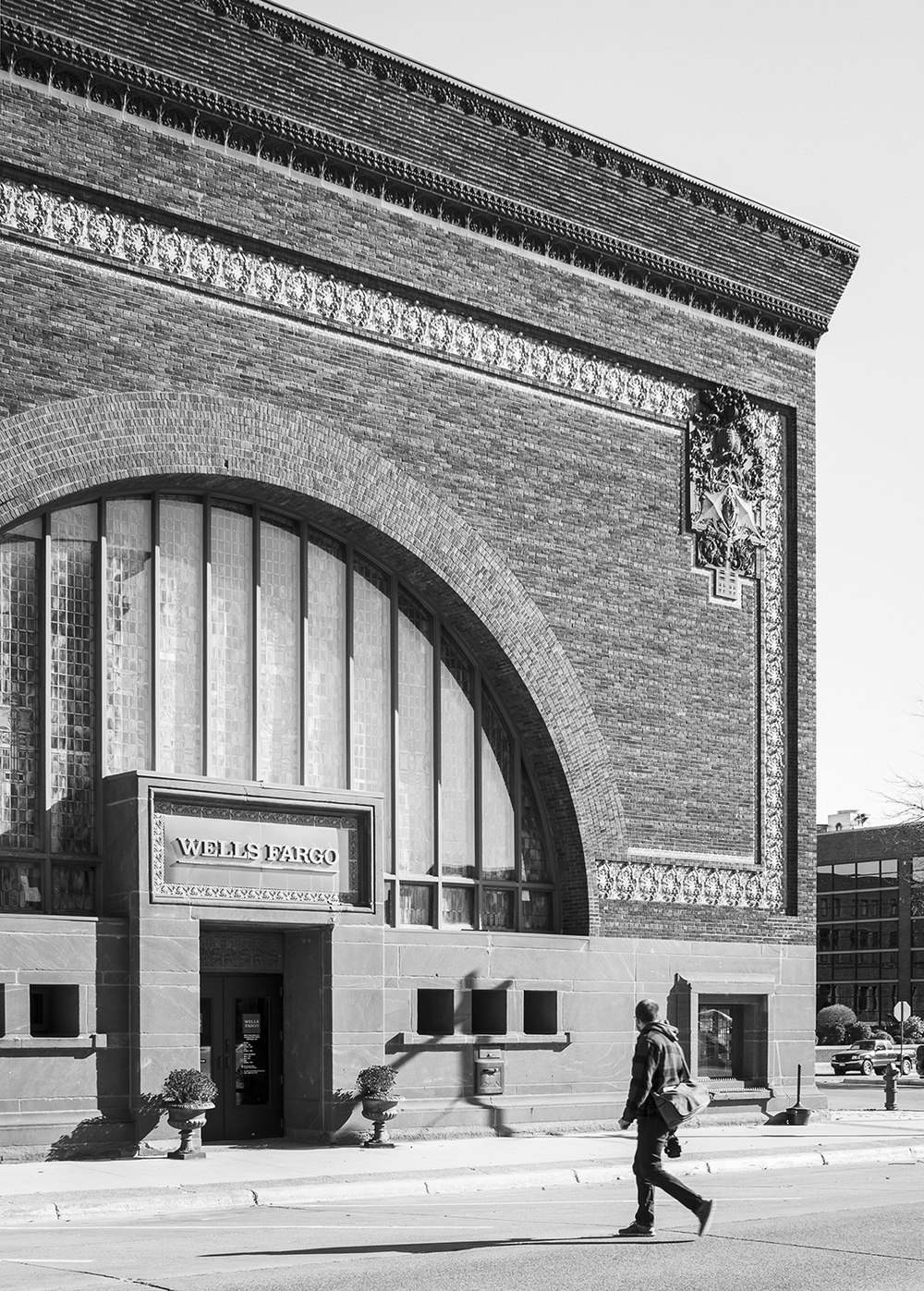 Photo of Corey Gaffer in front of National Farmers Bank in Owatonna by architect Louis Sullivan.  Photoby Peter Vondelinde