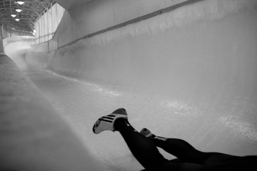 The legs of Savanah Graybill, from Denver, Pennsylvania, fly by as she racers down the track during her training run in Lake Placid, New York. Graybill has been a skeleton racer with the US National team since 2011. Olympic veterans and hopefuls in bobsled and skeleton gathered in Lake Placid, New York leading up to the World Cup Bobsled and Skeleton races held November 9-10, 2017. Results from Lake Placid, one stop along the circuit, will help determine teams for the 2018 Winter Olympics in Pyeongchang, South Korea.